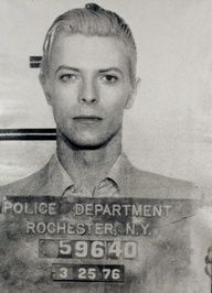 David Bowie mugshot. Bowie was arrested in Rochester, NY in 1976 on a felony pot possession charge. He was only in jail for a few hours, and police didn't snap his mugshot until three days after he was arrested when he returned to City Court for arraignment. 9 Old School Celebrity Mugshots - Instant Checkmate http://blog.instantcheckmate.com/9-old-school-celebrity-mugshots/#