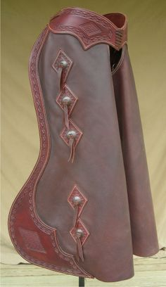 Supple leather and stamped belt and border make these chaps stand out. $750