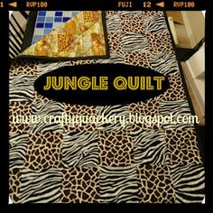 A jungle themed quilt for my friend.  Had some drama along the way but it is a beauty!