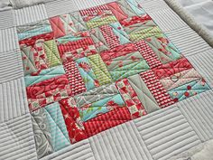 Straight lines (so simple but so pretty...lines)like the way is quilted