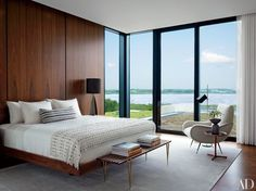 A bed custom made by LRS Designs and Modern Living Supplies anchors one of the master suites in this Hamptons house decorated by Randi Pucci   archdigest.com