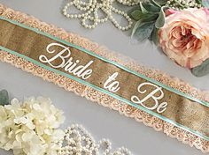 Want to stand out at your bachelorette party, Bridal Shower, or Baby Shower? it with our Custom Sashes! These sashes are personalized just for you. These rustic burlap and lace sashes are all hand made just for you and your friends. All sashes are made extra long and measure at 72 and are left open to fit most brides, and mommies to be. Each sash has a pin closure. Pictured is a burlap sash with peach lace and mint accent. If you have other colors in mind, just send me a message. We ...