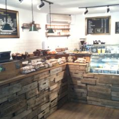 Coffee shop decor, love the stone, tile and wood. Very rustic!