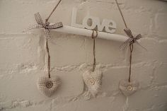 """Love"" Wall Hanger - Divine Shabby Chic Adorable wall hanger with gingham trim detail  Padded co-ordinating hearts hung from natural twine   Ideal addition to the home for a shabby chic twist      Was £6.50 Now £4.88"