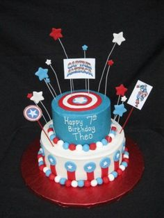 Captain America Cake ... this one is cool with the picks. Maybe SPARKLERS instead of candles?!?!?