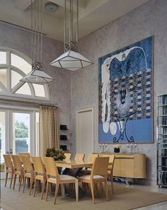 Incredible double height dining room with modern art.