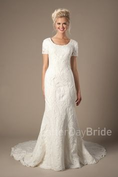 modest wedding dresses with lace | Palisade | LatterDayBride |  This lovely modest wedding gown features a lovely lace, an illusion half sleeve and a scoop neckline with a soft mermaid silhouette.    Gown available in Ivory or Champagne/Ivory  *Gown pictured in Ivory  Sleeve length or neckline can be customized.