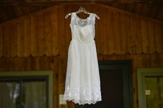 Casual, short wedding dress re-imagined from the bride's mother's original wedding dress. From Allie & Marko's DIY, colorful Virginia farm wedding. images by Bryan John Photography.