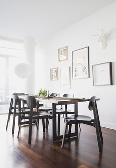 simple modern dining room with art wall