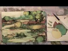 Alcohol ink painting tutorial.  How to paint with alcohol inks on a primed artist panel.  Step by step instructions for painting a landscape with alcohol inks.