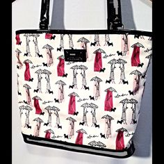 Lulu Handbag Girls & Umbrellas Adorable handbag/tote. Has a few yellow markings from use but not very noticeable. So cute! One of my favorites! Measures approx 13x11x4 Lulu's Bags