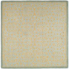 This Cambridge rug features handmade, wool construction and a soft 0.5-inch pile. This blue rug features a bold geometric pattern with accents of gold and varying pile heights for added interest.