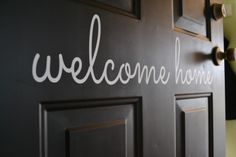 Adding a welcome home sign on the garage door to your house + a giveaway to win your own!