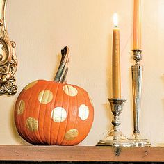 Give ordinary pumpkins a wow factor with gold metallic paint. Stick round labels on a pumpkin and trace the shape with a pencil before filling them in with paint.