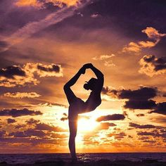 Wind down with some sunset beach yoga