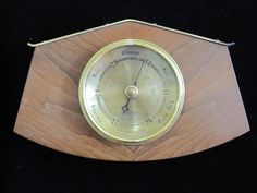 Vintage mid century English Shortland Brothers teak and brass barometer. - $30    This wonderful Shortland Brothers mid century modern barometer is a perfect classic vintage wall hanging weather man for your mid century home.    Brass cased bezel and fitted in a teak veneer, it works perfectly but does show some tarnishing on the brass and could use a polish.