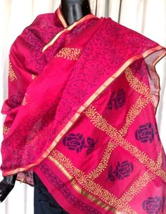 This beautiful hand block print chanderi dupatta has lovely tribal human figures in blue, and a golden border. Very graceful, and ideal for evening wear.  Will work great both as a dupatta, or as a scarf for your western dresses.  - See more at: http://www.giftpiper.com/HandBlockPrintChanderiDupattaPink-Floral-Pattern-id-680854.html#sthash.YmWIod2q.dpuf