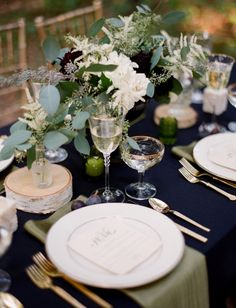 Dark linens, gold flatware & chargers.   Wedding Trends for 2013