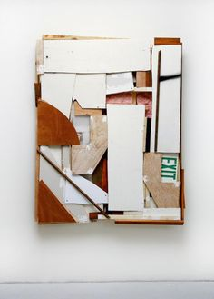 Wall Segment [Safe Exit] (2015), plastic, paper, plaster, wall insulation, and acrylic on wood assemblage, 56 x 69 x 9 inches