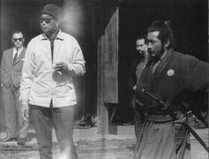 Master Yoshio Sugino (in the background) choreographing a fight scene on the set of Yojimbo with legendary director Akira Kurosawa and Toshiro Mifune . As a matter of fact, Mr. Mifune was a student of Katori Shinto Ryu under Master Sugino.