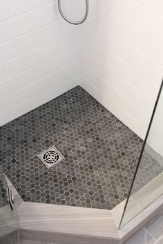 "Chase's bathroom:  Beautiful Bathroom Renovation Project Featuring 4"" x 12"" White Subway Tiles, 12"" x 24"" Gray Porcelain Floor Tiles, Riobel Shower Fixtures, Neo Angle Shower With 1"" x 1"" Gray Hexagon Mosaic Tiles, Kohler Toilet, Kohler Vanity Top With Kohler Vanity, Custom Frameless Shower Glass, And Floor Ditra-Heat By Schluter Systems."
