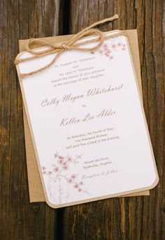 Cherry blossoms, tan envelopes, sweet invitations // Ron Dressel Photography