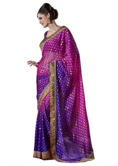 A saree in shade of  pink and purple with gold polka dots print