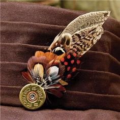 Feather Pin - Game Feather on Cartridge top Perfect for dressing your hat or lapel. Each pin is handmade from hand collected feathers from the moors of Scotland and the countryside then cleaned and fixed by hand. Each feather pin is unique. Feather Painting, Feather Art, Feather Jewelry, Pheasant Feathers, Bird Feathers, Shotgun Shell Crafts, Shotgun Shells, Shotgun Cartridges, Bullet Art