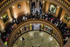 More than 150 protestors from Flint and Detroit chant in solidarity in the main lobby, asking for the resignation of Gov. Rick Snyder in relation to Flint's water crisis on Thursday, Jan. 14, 2016 at the Capitol in Lansing. Jake May | MLive.com