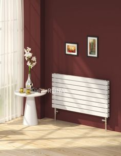 Reina Rione single radiator, this stylish white flat tube radiator can work on central heating, electric or dual fuel (perfect for summer months). it is 550mm in height and comes in 5 different horizontal lengths. It comes with a 5 year guarantee. Prices from £117.73!