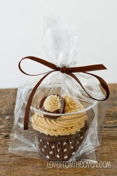 Need to package individual Cupcakes? Put them in a clear plastic cup, put the cup in a bag, tie with a ribbon and voila! - Continued!