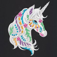 Pops of bright color and fun floral shapes adorn this dimensional unicorn.