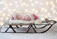 perfect babys first christmas picture - aww - I have one of these sleds. :)
