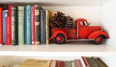 Red toy farm truck as a book end Farm Trucks, Toy Trucks, After Christmas, Christmas Things, Ikea Billy Bookcase, Kids Decor, Home Decor, Kidsroom, Fashion Books