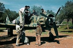 british-eevee:  MC.200 being rearmed in a field (Date and...
