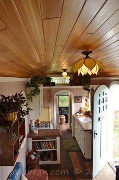 From the vintage fridge to the glass light fixtures, this is the closest thing to a cottage I've seen, on wheels!