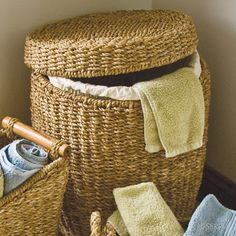 Lined Laundry Basket  Lidded hogla grass basket with metal frame has a removable cotton liner for laundry, or use it as a small storage table and fill with blankets or toys. #fairtrade www.serrv.org