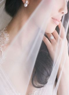 gorgeous and romantic ring shot. Love it with the veil but I don't think I'm wearing a veil