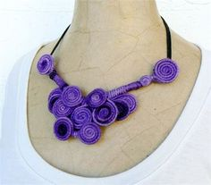 Wire wrapped Bib necklace, Purple lilac Choker, Wearable art jewelry, Fiber quirky necklace, Whimsical short necklace, Cool violet swirl bib.   This is a bright colorful bib with free-form swirls turning into this unique design. It hangs from two black waxed linen threads and has a silver metal clasp on top. The length can be adjusted using the chain that hangs from one extreme.   Wire wrapped pendant: 6.29 x 5.91 (16 x 15 cm) Bib length (from end to end): 22.04 to 25.2 (56 cm to 64 cm)…