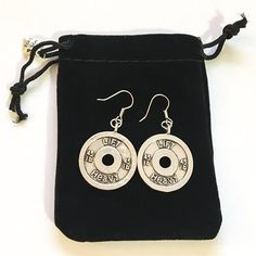 — Each pair of earrings represents your unique journey, while being a reminder to never give up! Description:Earrings include a pair of pictured stainless steel earring hooks with two 45lbs 'Lift Heavy' Weight Plate charms. Material: Each earring hook is made of hypoallergenic Heavy Weight Lifting, Lift Heavy, Gifts For Gym Lovers, Meaningful Jewelry, Stainless Steel Earrings, Fitness Gifts, Coach Gifts, Dainty Necklace, Earring Backs