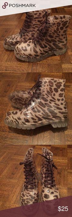 Animal Print Combat Rain Boots Sz 9 Super cute animal print combat style rain boots Lined for comfort Size 9 New, in box, never worn Diviana Shoes Winter & Rain Boots