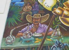 El coronel Aureliano en el laboratorio de alquimia con los pescaditos de oro. Al fondo Jose Arcadio Buendia amarrado al castaño con Ursula Iguaran