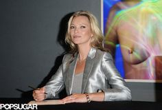 Only Kate Moss Can Rock a Silver Suit in Front of Her Own Topless Photo: Kate Moss signed copies of her art prints at Christie's auction house in London.