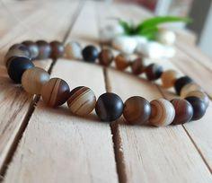 Check out this item in my Etsy shop https://www.etsy.com/listing/491262364/10mm-matte-brown-persian-agate-bracelet