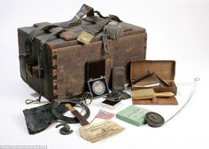 Officer's footlocker with belongings, 1860-1890. This trunk belonged to Lieutenant Colonel William H. Pain, a topographical engineer from New Hampshire. In it, he carried all of his clothing and all of the items he needed at war.
