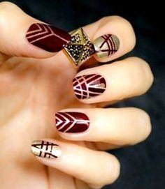 Maroon and gold nails: