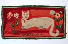 Fantastic Folky Cat Hooked Rug »    Circa 1920-1940: Great naive expression on this wide eyed folk art cat hooked rug. Large bold flowers flank both sides of this Welcome rug. The great large white cats tail curves down and breaks the space in a delighful primitve way. Bold reds contrast with the great white cat and create a stunning visual piece of American folk art.