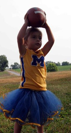 Wouldn't this be a cute outfit for a flower girl at a U of M themed wedding? It would be super cute to dress the flower girl in a cheerleading costume and the ring bearer in a mini football player or mini basketball player uniform. #UMich #Michigan #UofM