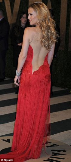 I want this dress!!    Ravishing: Goldie Hawn looked ravishing in a red fringed and beaded gown