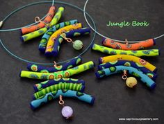 Polymer clay totem pendants by Caprilicious Jewellery